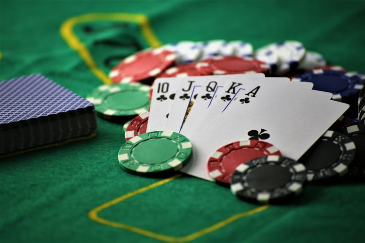An concept Image of a poker table Luck Poker RISK Win Bet Betting Chance Close-up Concept Gambling Gambling Chip Indoors  Luck Money No People Play Playing Table Tablecloth