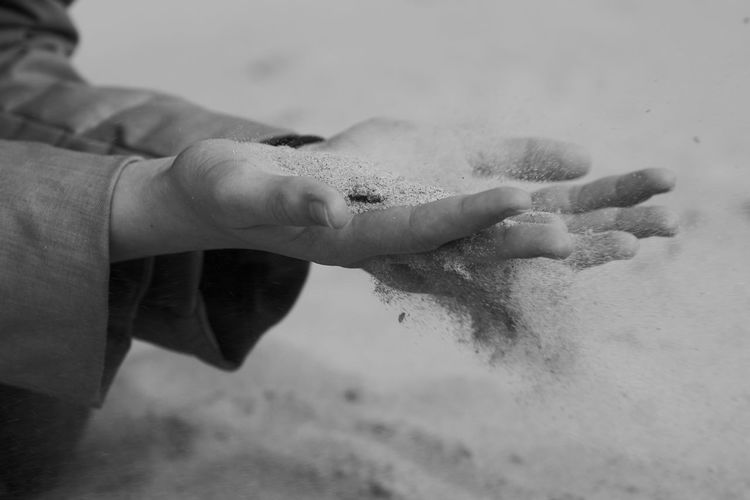 Close-up Focus On Foreground Human Body Part Human Hand Leisure Activity One Person Real People Sand