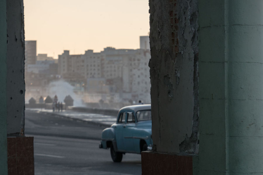 Malecón before sunset Afternoon Sunlight Architecture Building Exterior Built Structure Car City Cuba Cuba Collection Cuban Cars Day Focus On Foreground Land Vehicle Malecon No People Outdoors Sky Tourist Attraction  Transportation Travel Photography