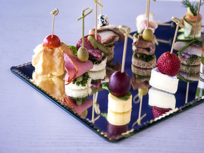 Close-up of various canapes and snacks served on table