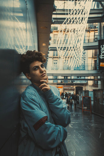 Young Adult One Person Window Real People Young Men Looking Portrait Looking Away Lifestyles Architecture Waist Up Leisure Activity Contemplation Glass - Material Sitting Built Structure Indoors  Warm Clothing