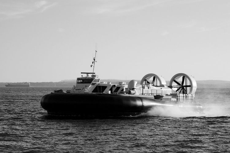 Hovercraft Arriving Nautical Vessel Water Sky Transportation Mode Of Transportation Waterfront Sea Day Clear Sky Outdoors Travel Motion Passenger Craft Hovercraft Blackandwhite Black And White