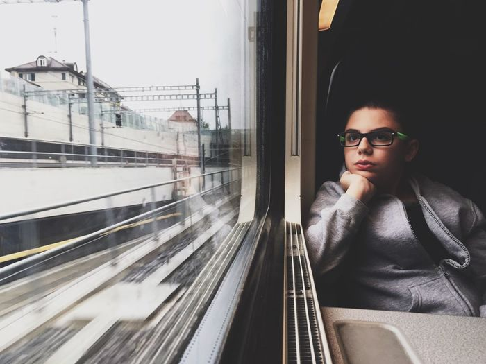 Traveling Home For The Holidays Eyeglasses  One Person Contemplation The Portraitist - 2017 EyeEm Awards Reflection Waiting Transportation Front View Adults Only Public Transportation מיימרקט Subway Train People One Man Only Day Men Young Women Only Men מייגיא מיישוויץ Mytrainmoments Mydtrainmoments Switzerland It's About The Journey