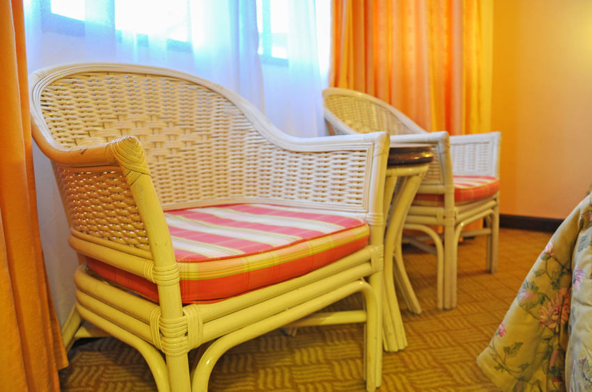 Rattan chair at the corner of hotel room Arm Chair Chair Curtain Day Hotel Hotel Room Indoors  Inside Hotel No People Rattan Chair Red Relaxing Round Table Sit Table