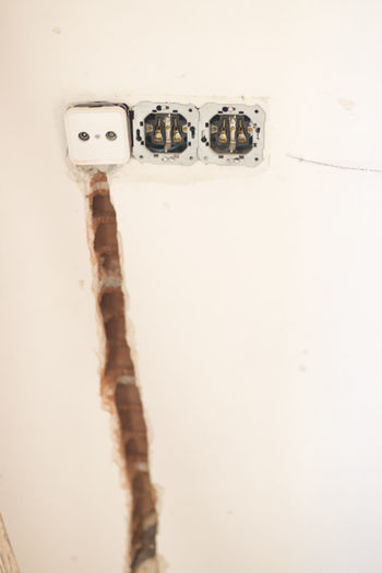 Close-up of old electric lamp on wall
