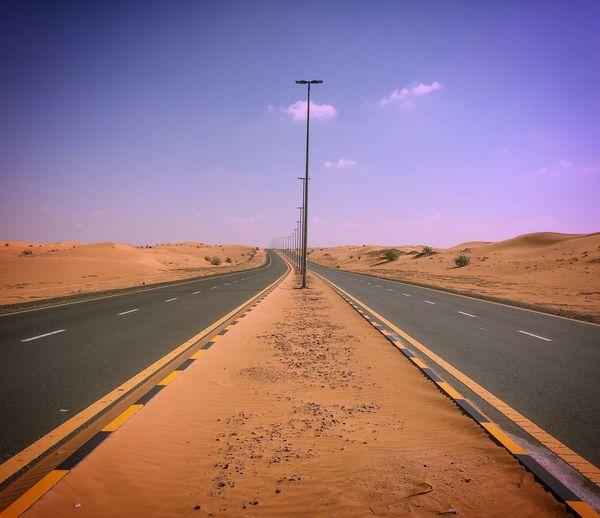Road Amidst Desert Against Sky