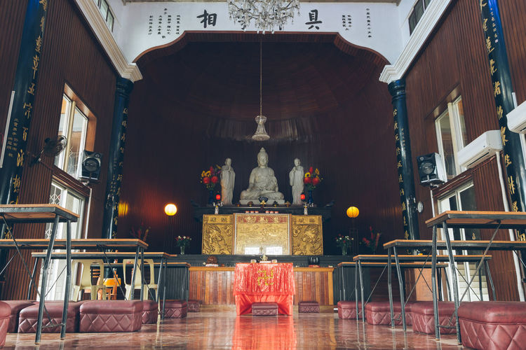 Inside of Buddhist temple in Davao Built Structure Architecture Place Of Worship Building Religion Spirituality Belief Illuminated Altar No People Travel Destinations Davao Buddhist Temple Buddhism