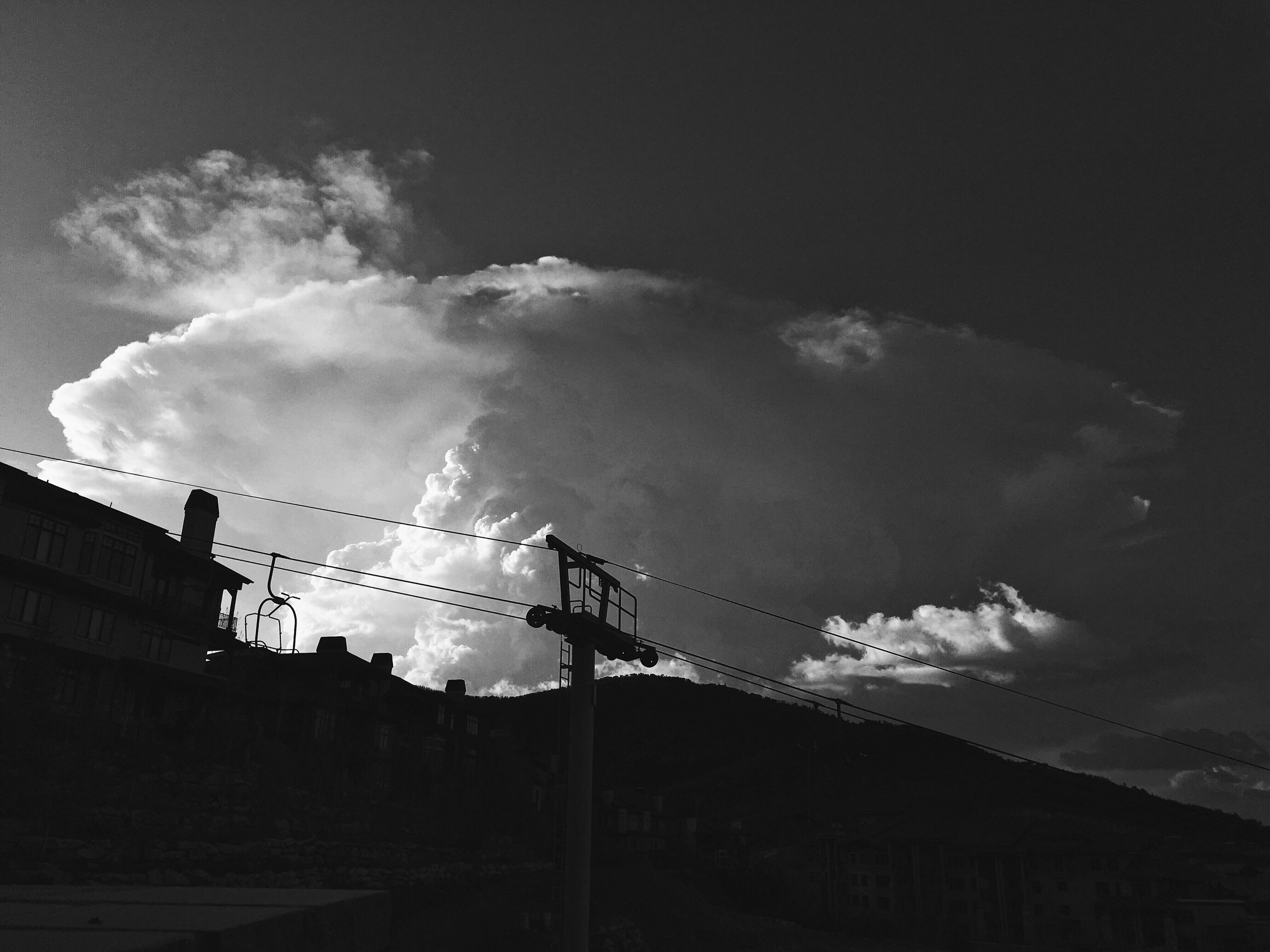 sky, cloud - sky, low angle view, connection, cable, silhouette, outdoors, no people, built structure, electricity, architecture, day, electricity pylon, building exterior, factory, nature, telephone line
