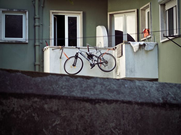 Bicycle Building Exterior Built Structure Architecture Transportation Building Day Land Vehicle Window Mode Of Transportation Outdoors Residential District Wall City Stationary People Wall - Building Feature Nature
