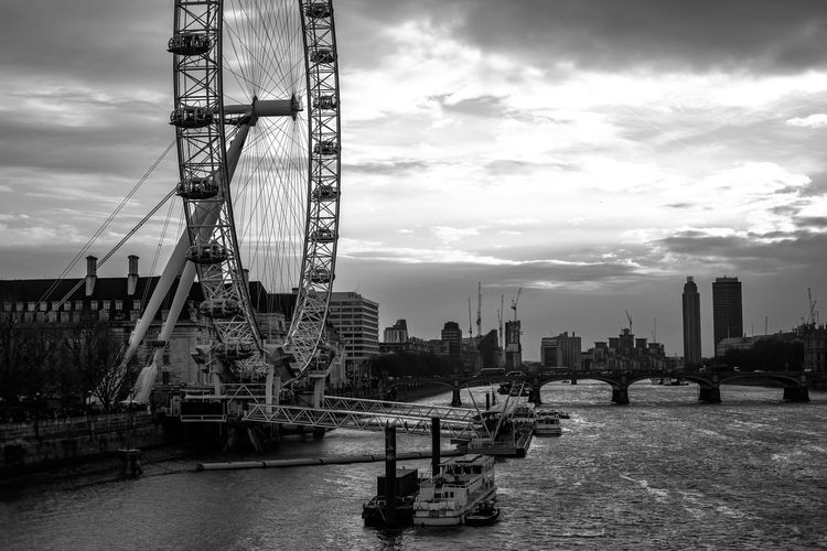 Ferry Boats In Thames River By London Eye Against Sky
