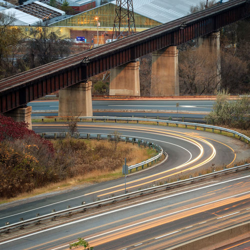 Early morning traffic floats in beams along Toronto's Don Valley Parkway Don Valley Speeding Toronto Traffic Architecture Bridge - Man Made Structure Built Structure Connection Curve Day Highway Motion No People Outdoors Road Speed Transportation