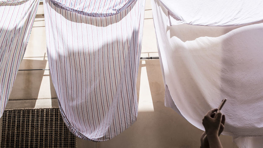 Bed Bedroom Clothing Curtain Day Domestic Room Furniture High Angle View Home Interior Indoors  Lifestyles Linen Low Section One Person Real People Textile White Color