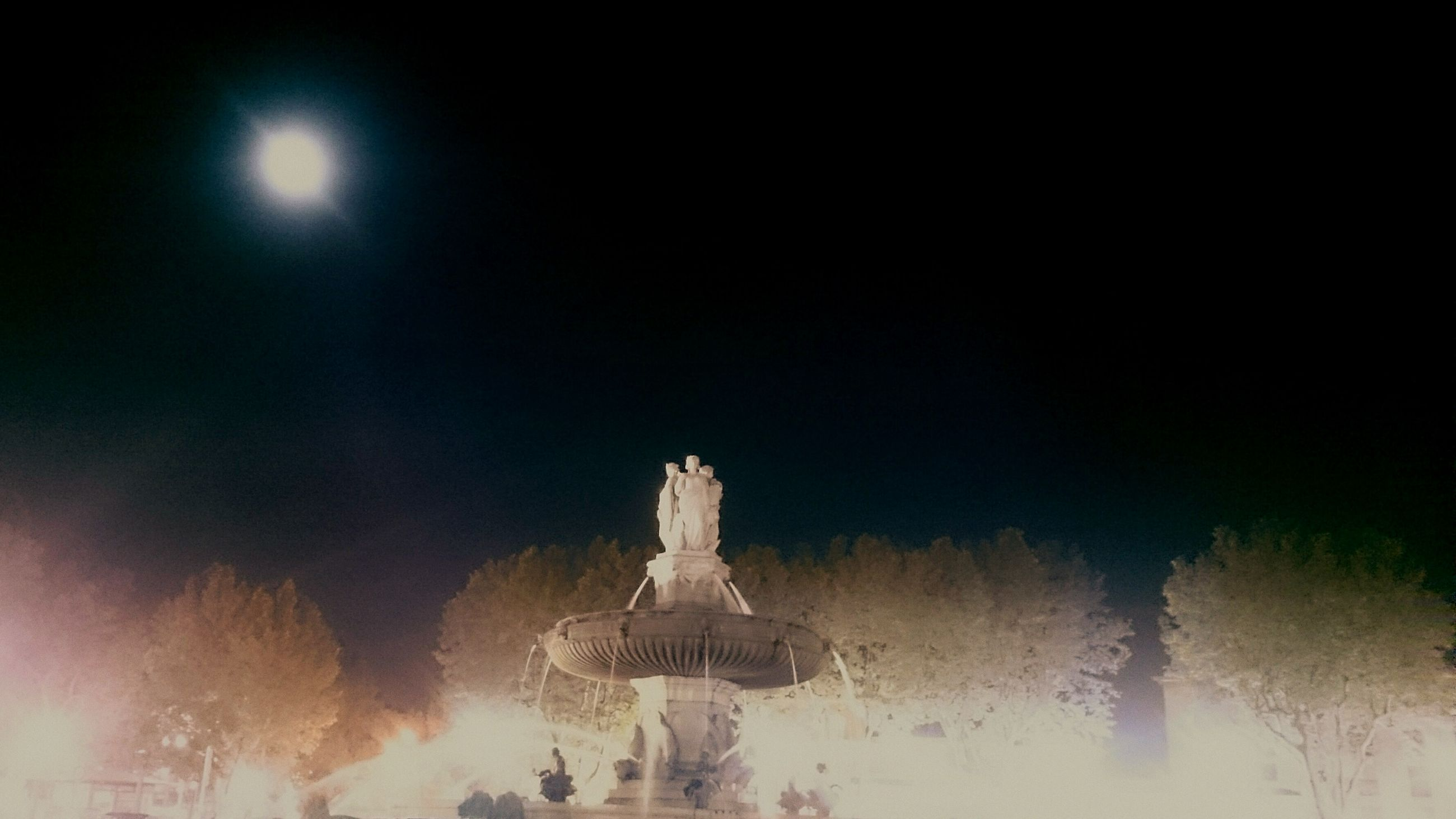 architecture, built structure, illuminated, night, religion, sculpture, building exterior, art and craft, statue, low angle view, sky, famous place, history, art, spirituality, travel destinations, water, place of worship, creativity, copy space