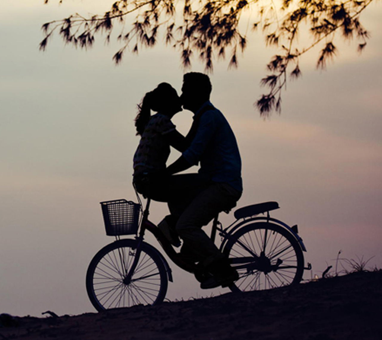two people, togetherness, sunset, love, bicycle, silhouette, couple - relationship, bonding, outdoors, sitting, side view, men, full length, tree, women, real people, childhood, motorcycle, nature, adult, day, sky, young adult, people