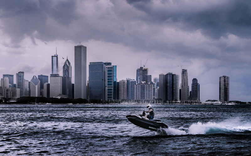 Stormy summer afternoon looking over Lake Michigan towards downtown Chicago. Illinois, USA. Love Life, Love Photography Chicago Skyline Chicago Architecture Illinois Lake Michigan Chicago Stormy Weather USA Architecture Building Exterior Built Structure City Cityscape Cloud - Sky Jetski Modern Motion Nature Office Building Exterior Outdoors Sea Sky Skyscraper Storm Cloud Urban Skyline Water Waterfront