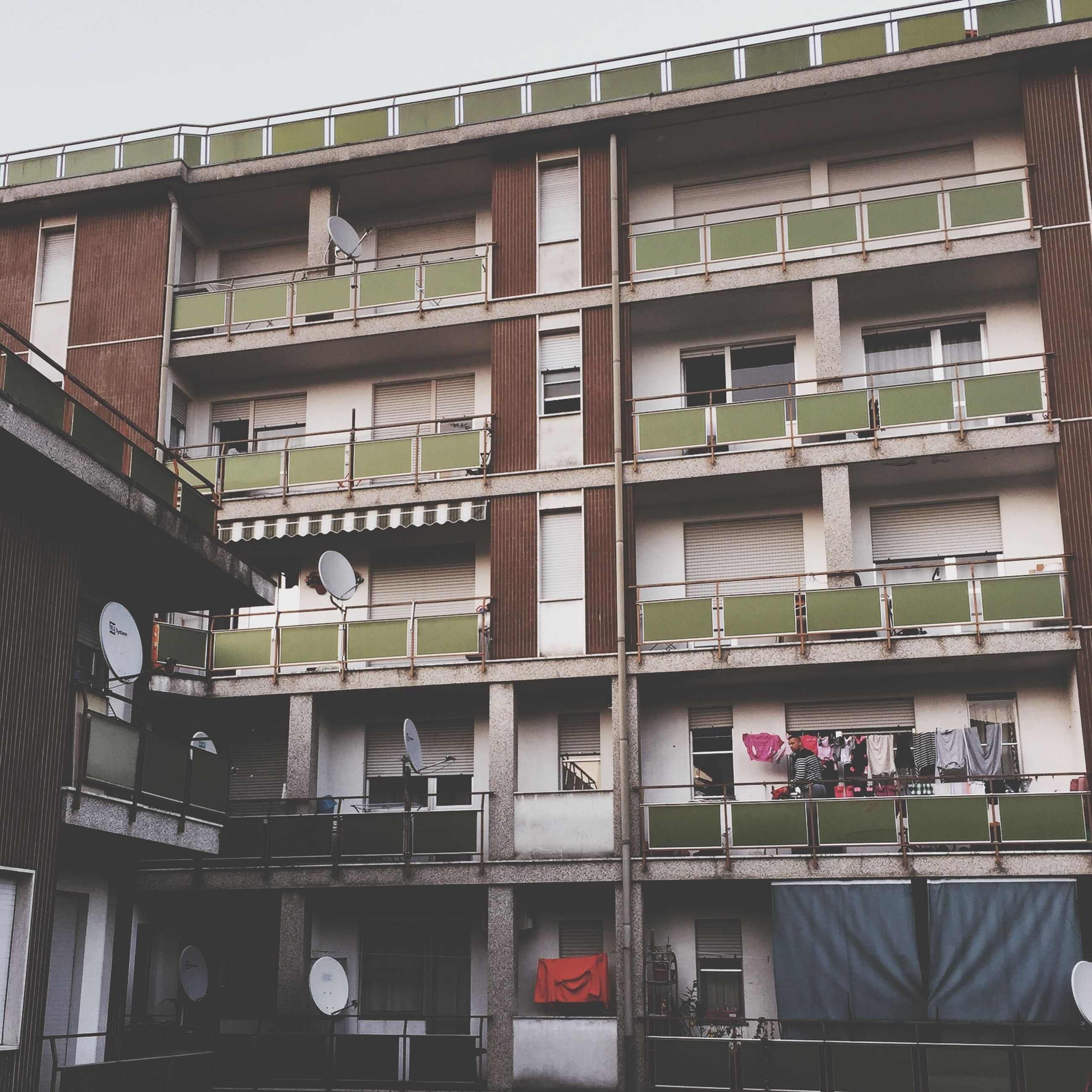 architecture, building exterior, built structure, window, low angle view, building, residential building, balcony, city, glass - material, residential structure, modern, day, apartment, outdoors, office building, no people, in a row, facade, exterior