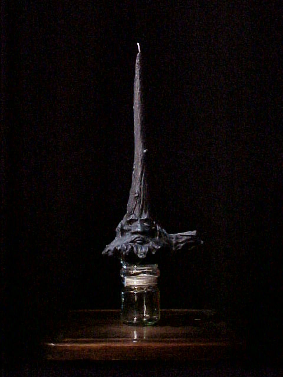no people, statue, night, indoors, black background, close-up