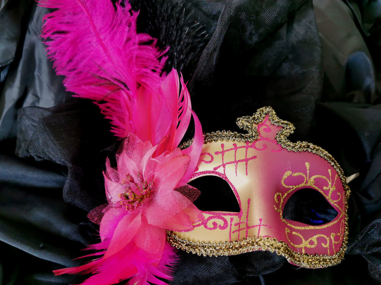 close-up, pink color, flowering plant, flower, day, no people, mask, disguise, plant, mask - disguise, outdoors, celebration, focus on foreground, nature, creativity, venetian mask, costume, carnival - celebration event