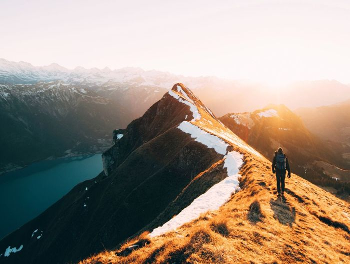 Finding New Frontiers Mountain Adventure Climbing Hiking Snow Mountain Range Sunset Scenics Rock - Object Extreme Sports Outdoors Landscape People Winter Sky Ridgeline Switzerland