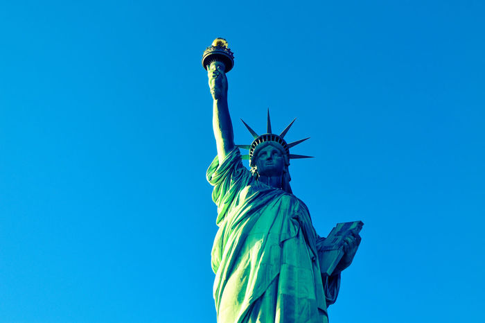 Freedom Hope Liberty Liberty Island Statue Of Liberty Art And Craft Blue Clear Sky Crown Day Female Likeness Freedom Human Representation Liberty Statue Low Angle View Madam No People Outdoors Sculpture Sky Statue Travel Travel Destinations