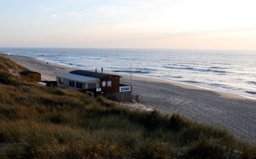 Strandsauna Sylt Abend Abenddämmerung Abendsonne Beach Life Beach Sauna Nordsee Feeling🐚🌾 Nordsee Landscape Rantum Strand Strandsauna Sylt Abend Am Meer Beach Beachphotography Beauty In Nature Cloud - Sky Grass Horizon Horizon Over Water Land Motion Nature No People Nordseeinsel Nordseeküste Plant Sand Scenics - Nature Sea Sky Sunset Tranquil Scene Tranquility Water