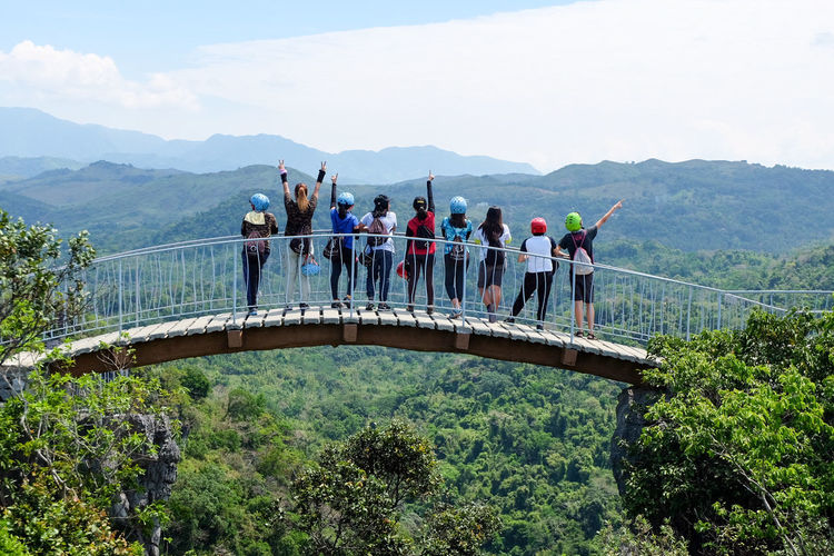 Mountain Mountain Range Bridge - Man Made Structure Adults Only People Adult Outdoors Day Togetherness Nature Occupation Men Headwear Sky Only Men Masungi Georeserve Masungi Rock Formations Masungi Philippines Friendship Team Teamwork Be. Ready. Inner Power Go Higher