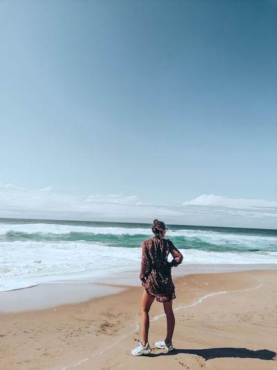 One girl standing in the beach of praia de adraga