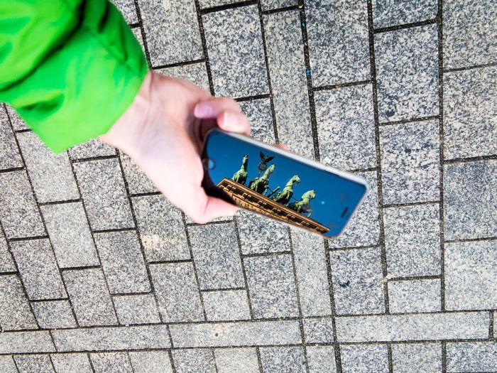 Reflection of brandenburg gate in smartphone