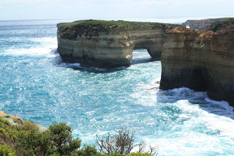 Sandstone archway Beauty In Nature Blue Cliff Day Horizon Over Water Natural Arch Nature No People Outdoors Physical Geography Power In Nature Rock - Object Rock Formation Scenics Sea Sky Sunlight Tranquility Travel Destinations Water Wave