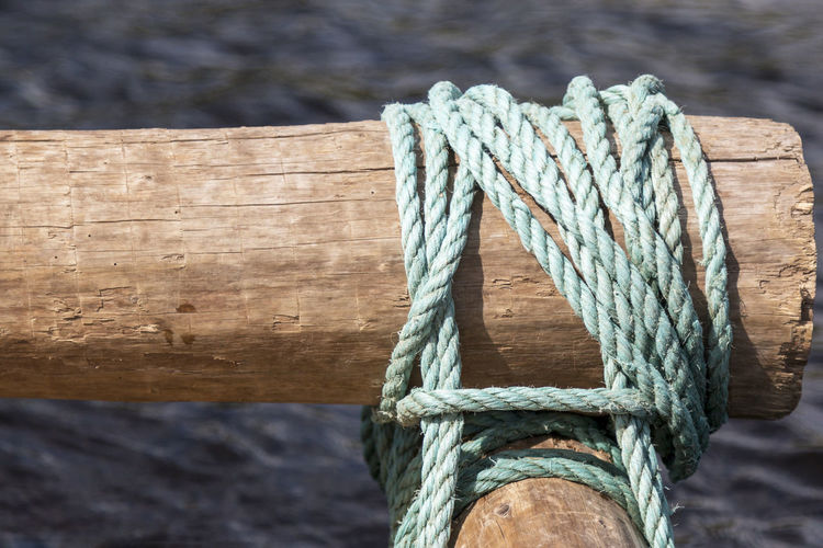 Close-up of rope tied on wooden post Rope Tied Knot Wood - Material Nautical Vessel Sea Strength Close-up Tied Up String No People Old Backgrounds Brown Plank Sailing Nature Twisted Moored Rough Focus On Foreground Textured  Connection Day Water Outdoors Pattern Wooden Post Wood Raft Rafting Klarälven
