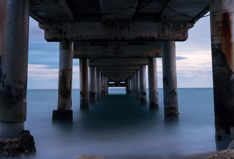 Long Exposure Light Marbella Underneath Water Sea Beach Architectural Column Pier Sunset Below Architecture Horizon Over Water EyeEmNewHere Stories From The City