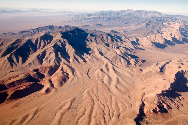Aerial View Arid Climate Barren Beauty In Nature Day Desert Extreme Terrain Famous Place Geology Idyllic Landscape Mountain Mountain Range Natural Pattern Nature Non-urban Scene Physical Geography Remote Rock Formation Scenics Sky Tourism Tranquil Scene Tranquility Travel Destinations