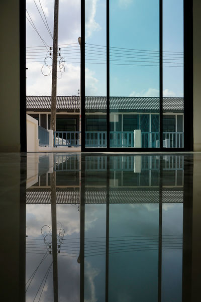 reflection scene of hometown on the floor Background Beautiful Lifestyles Pattern Shadow Color Art Abstract Architecture Reflection Window City Business Finance And Industry Politics And Government Cloud - Sky Sky Façade Steel Crime Water Symmetry No People Architecture Cityscape Day