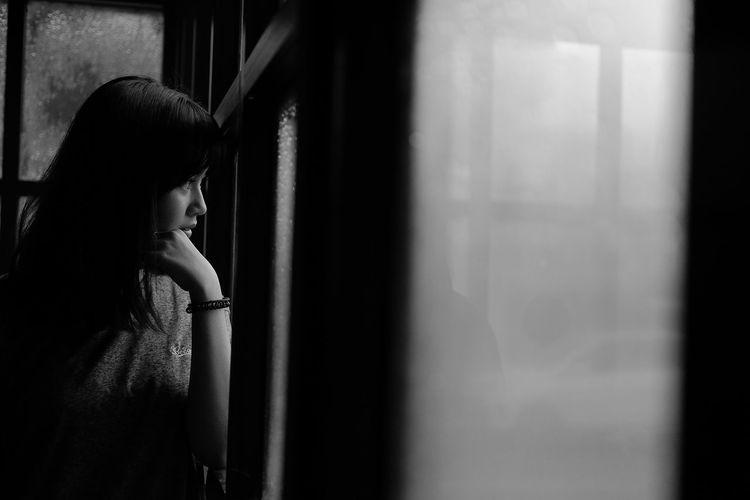 Blackandwhite Depression - Sadness Sadness One Person Emotion Solitude Adult Contemplation Women Emotional Stress Despair Females Child Dark Indoors  Window