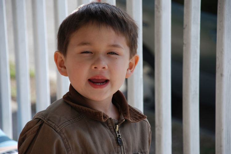 Young boy complaining. Asian  Attitude Boy Brown Jacket Caucasian Child Childhood Close-up Complaining Half Asian One Person Real People
