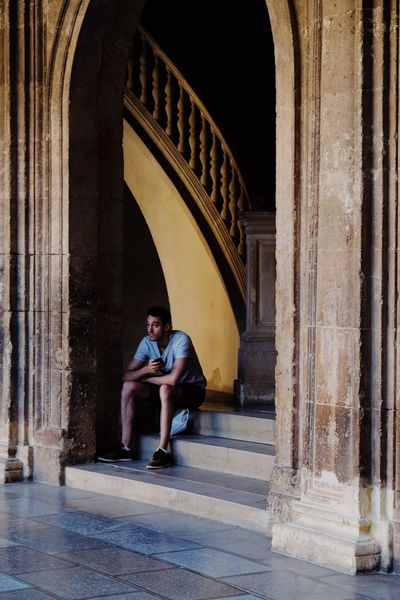 Roadtrip around Andalusia/Spain. 2nd Stop: Granada Architecture Built Structure Arch Sitting History Architectural Column Leisure Activity Day Arcade Architecture Architecture_collection Architectural Feature Framed Streetphotography Street Photography Contemplation Travel Travel Destinations Travel Photography