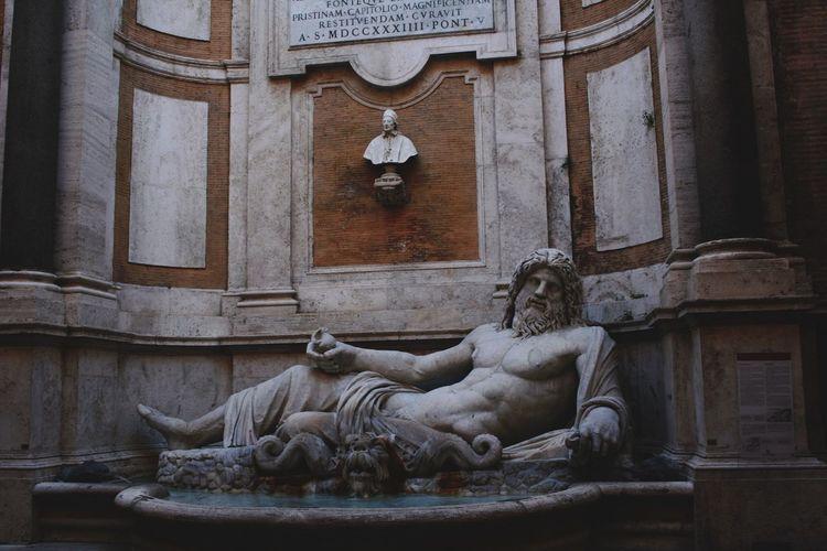 Statue against statues
