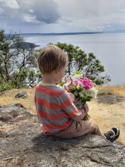 Designated flower holder at a wedding 😊😊❤️❤️ He took it seriously. Flowers Wedding Photography Summer PNW Trees Up Scenics Child Flower Childhood Sea Beach Sand Sand Dune Horizon Over Water Ocean