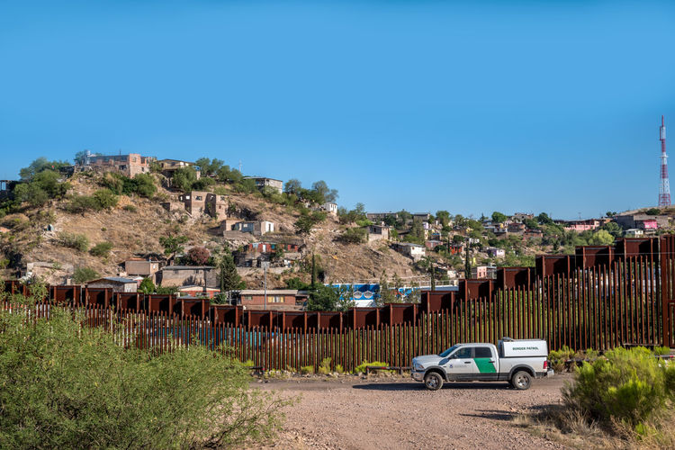 United States - Mexico border fence in Nogales, Arizona Arizona Barricade Barrier Border Border Patrol Building Exterior Built Structure Feder Federal Government Government HOMELAND SECURITY Illegal Immigration Immigration Reform Mountain Nogales Nome Politics Politics And Government Seperation US Mexican Border Us Mexico Border