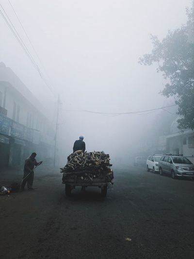 People on street in foggy weather