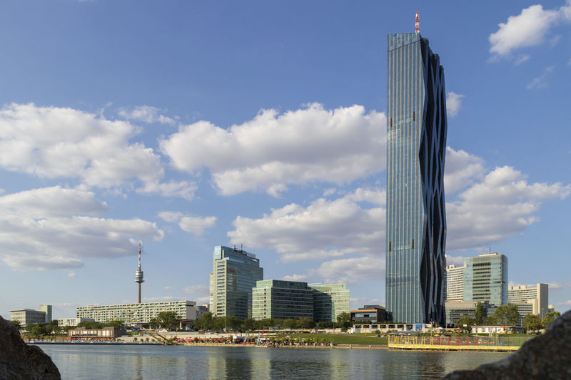 Amazing Skyline of Donau City Vienna Donau Hochhaus Skyline Vienna International Airport Architecture Building Built Structure City Cityscape Cloud - Sky Day Donauinsel Modern Nature Office Outdoors River Sky Skyscraper Tall - High Tower Urban Skyline Water Waterfront Wien