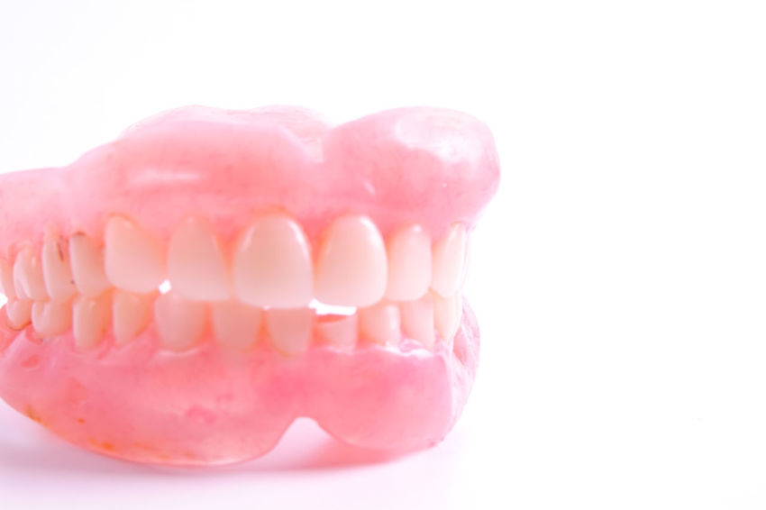 A set of dentures isolated on a white background. Dentures Dentist Studio Shot Pink Color Indoors  Close-up White Background White Medical Health Eldery People
