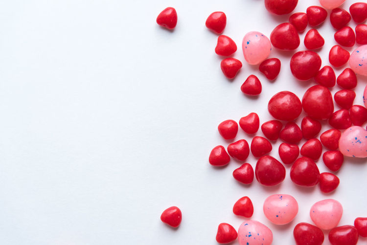 Scattered Valentine's Day cinnamon heart candies with red and pink jelly beans on white background Bright Celebration Copy Space Happy Holiday Love Pink Candy Romance Romantic Valentine Valentine Candy Valentine's Day  White Space Candy Cheerful Cinnamon Hearts Close-up Colorful Hearts Jelly Beans Pink And Red Red Red Candy Symbol White Background
