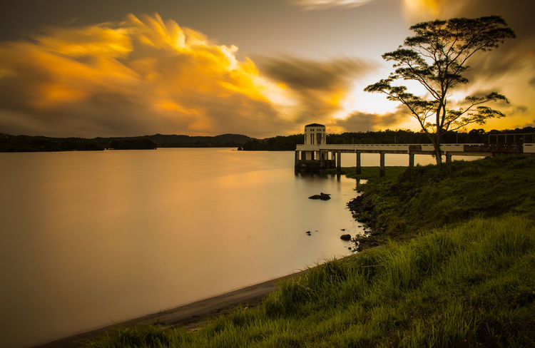 Caliraya Lake Caliraya Calirayalake Laguna Scenics - Nature Water Sky Cloud - Sky Tranquility Built Structure Reflection Orange Color Outdoors No People Beauty In Nature Tranquil Scene