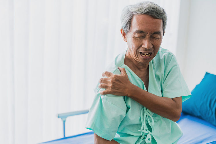 Patient With Shoulder Pain In Hospital