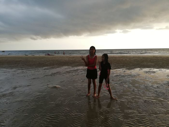 Children enjoy on summer trip 2019,หาดเจ้าหลาว Beach Sea Sky Water Horizon Over Water Land Horizon Real People Cloud - Sky Sand Beauty In Nature Togetherness Scenics - Nature Leisure Activity Nature Rear View Bonding Lifestyles Full Length