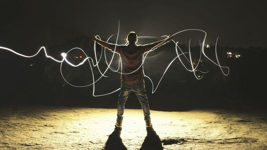Playing With Lights Light And Shadow Lightpainting Long Exposure Freedom Shadow Rock One Man Only Night One Person Adult Motion Adults Only Only Men Standing Indoors  People Young Adult EyeEmNewHere AI Now EyeEm Ready   This Is Masculinity Inner Power