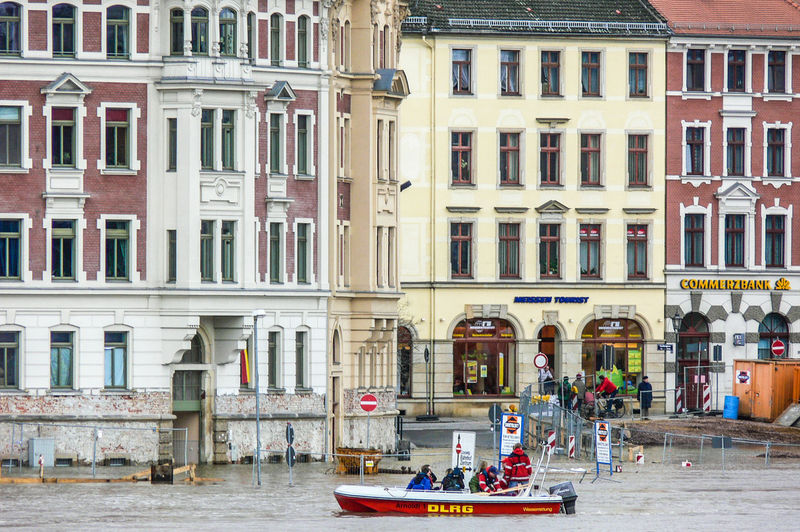 Meissen in Saxony the porcelaine town, Elbe River hig water Desaster Natural, Desaster Struck DLRG Boat Helping Architecture Building Exterior Built Structure City Day High Water Level Nautical Vessel Outdoors People Real People Residential Building Transportation Water Waterfront Window Men