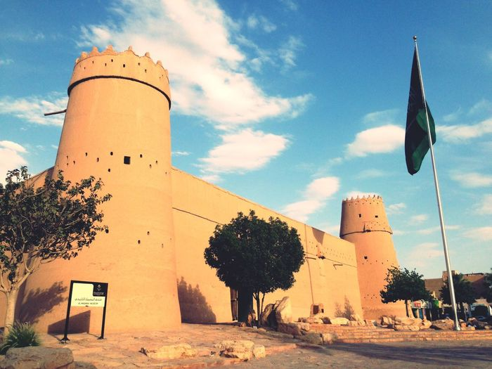 Castle of King ABDULAZIZ, king of Saudi Arabia Castle Old Ancient Sunlight Day Flag Building No People Outdoors Tower Low Angle View Plant Tree History The Past EyeEmNewHere EyeEmNewHere