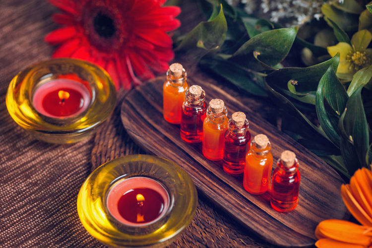Aromatherapy Aromatherapy Aromatherapy Oil Essential Oils Orange Red Bottles Spa Wellness Relax Glass Therapy Blue Natural Aromatic Brown Care Treatment Healthy Perfume Candles Essence Green Fragnance Organic Health Aroma Fresh Alternative Relaxation Lifestyle Decoration Cosmetic Ingredient Skincare No People Table Candle Flower Indoors  Leaf Wood - Material Freshness